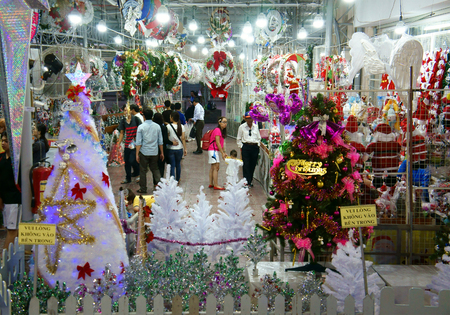 market place: HO CHI MINH CITY, VIET NAM- DEC 17: Vietnamese people shopping at market place to buy ornament for Christmas holiday, colorful decoration for winter season show at store, Saigon, Vietnam, Dec 17, 2014