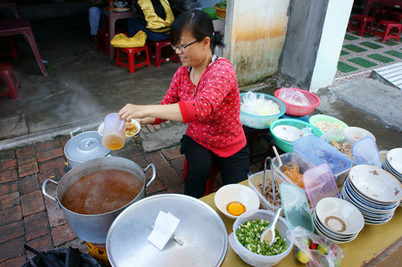 HO CHI MINH CITY, VIET NAM- AUG 22: Vietnamese street food, food vendor sale streetfood on pavement, this kind of eating very cheap, fast, can for snack or  meal of day, Saigon, Vietnam, Aug 22. 2015 Editorial