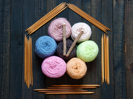 Handmade clock from group of colorful ball of wool, amazing design for new year, time pass never return, abstract concept, nice background, wooden clockwise