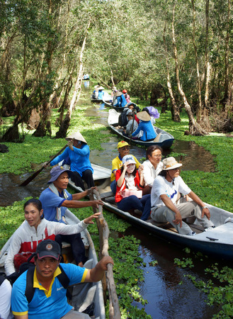 ecotourism: AN GIANG, VIET NAM- OCT 17: Group of traveler traveling nature landscape at Chau Doc, Mekong Delta, Tra Su indigo forest, crowded of people on row boat, make ecotourism, Angiang, Vietnam, Oct 17,2015