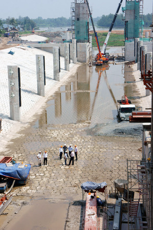 longan: LONG AN, VIET NAM- OCT 14: Asian worker working at construction site, a dredge the river bed project, make a solid irrigation system with concrete dam, Longan, Vietnam, Oct 14, 2015 Editorial