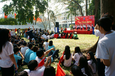 highschool: HO CHI MINH CITY, VIET NAM- FEB 9: Group of Asian highschool student in outdoor activity when join spring camp, crowd of teen girl, teen boy sitting and join music, Saigon, Vietnam, Feb 9, 2015