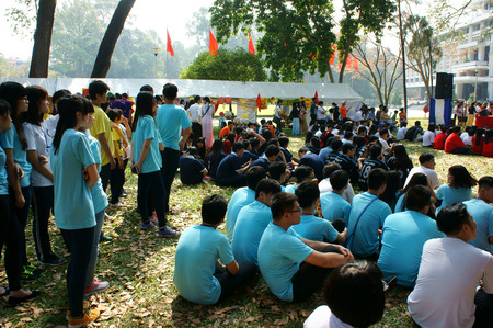 teen girl: HO CHI MINH CITY, VIET NAM- FEB 9: Group of Asian highschool student in outdoor activity when join spring camp, crowd of teen girl, teen boy sitting and join music, Saigon, Vietnam, Feb 9, 2015