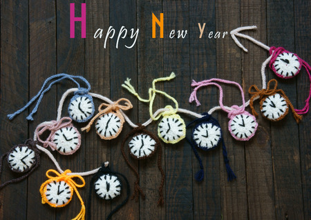 time zone: Handmade design from yarn, group of colorful clock with many time zone to happy new year 2016, eve moment, amazing with knitted product on wooden background