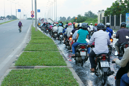 the flood tide: HO CHI MINH CITY, VIET NAM- OCT 10: Crowd of city resident hard to move on flooded road by flood tide at evening, climate change make sea level rise, motorbike move in water, Vietnam, Oct 10, 2014