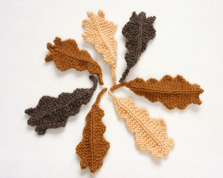 acorn: Handmade product for winter holiday, group of knitting ornament as leaf, acord, clock, mushroom, strawberry, pine tree, hat, mitten, scarf, acorn for Christmas decoration