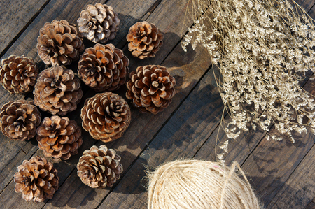 pinecone: Group of pine cone to decorate on Christmas holiday, brown pinecone with shadow on wood background