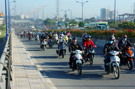 co2 emissions: HO CHI MINH CITY, VIET NAM- NOV19: Crowded of motorcycle, moving transfer on street in rush hour, dusty, CO2, exhaust fumes from vehicle, overload Asia urban, environment problem, Vietnam, Nov19, 2015