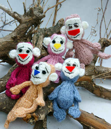 stuffed animal: 2016, year of monkey, symbol of intelligent, lucky, agile, group of handmade monkey on branch of tree with banana, knitted toy as stuffed animal make from yarn,  hand made product on white background