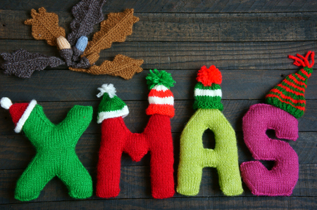 yarn: Christmas background, Xmas alphabet handmade by knitted, amazing ornament for noel as letter, gift, hat knit from red and green yarn, so amazing hand made product for winter holiday Stock Photo
