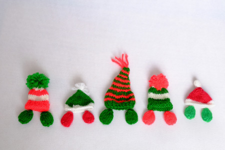 christmas bird: Christmas background, Xmas alphabet handmade by knitted, amazing ornament for noel as letter, gift, hat knit from red and green yarn, so amazing hand made product for winter holiday Stock Photo