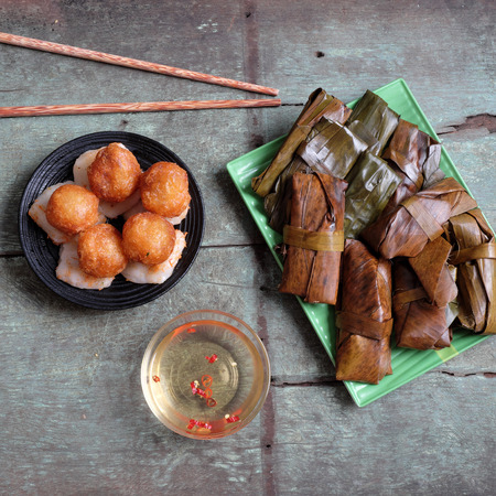 Vietnamese food, a special street food from Hue cuisine, make from rice flour with meat, shrimp, pack with banana leaf, call banh nam, banh bot loc, a famous Vietnam food