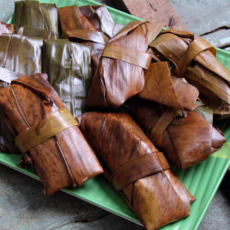 loc: Vietnamese food, a special street food from Hue cuisine, make from rice flour with meat, shrimp, pack with banana leaf, call banh nam, banh bot loc, a famous Vietnam food