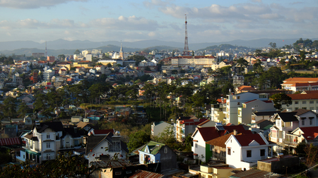 dalat: DA LAT, VIET NAM- DEC 30: Panorama of Dalat city from Tran Hung Dao street, residence  among pine forest, ancient architect far away, urban scene on mountain terrain, Dalat, Vietnam, Dec 30, 2015