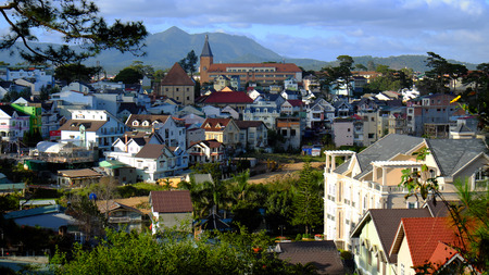 tran: DA LAT, VIET NAM- DEC 30: Panorama of Dalat city from Tran Hung Dao street, residence  among pine forest, ancient architect far away, urban scene on mountain terrain, Dalat, Vietnam, Dec 30, 2015