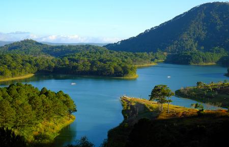 jungle scene: Tuyen Lam lake at Dalat, Vietnam, beautiful landscape for eco travel at Viet Nam, amazing lake among pine forest make wonderful scene, boat on water, Da Lat countryside  is famous place for  holiday