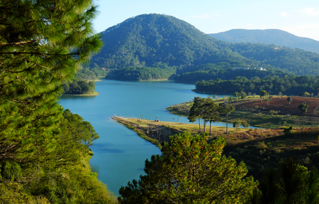 dalat: Tuyen Lam lake at Dalat, Vietnam, beautiful landscape for eco travel at Viet Nam, amazing lake among pine forest make wonderful scene, boat on water, Da Lat countryside  is famous place for  holiday