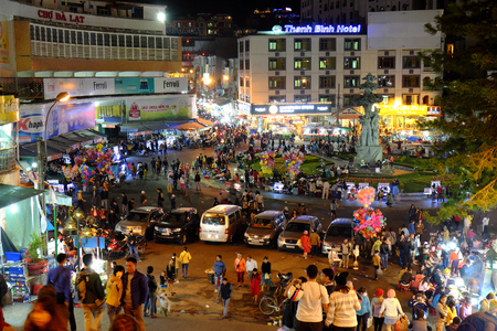 dalat: DA LAT, VIET NAM- DEC 30: Crowded atmosphere at Dalat night market, traveler enjoy walking and shopping at open air market in cold weather, light on street, crowd at marketplace, Vietnam, Dec 30,2015