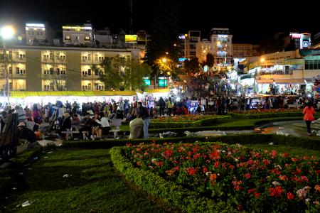dalat: DA LAT, VIET NAM- DEC 30: Crowded atmosphere at Dalat night market, traveler enjoy walking and shopping at open air market in cold weather, light on street, crowd at marketplace, Vietnam, Dec 30,2015