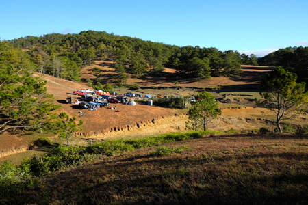 dalat: DA LAT, VIET NAM- JAN 2: Group of person  in family vacation in spring, people with 4x4 terrain car camp at pine forest, exciting experience in eco travel with tent, Dalat, Vietnam, Jan 2, 2016