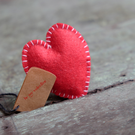 lonely heart: Red Valentine heart on wood background, one lonely heart in Valentine day, a special day for couple on feb 14, a abstract concept for love Stock Photo