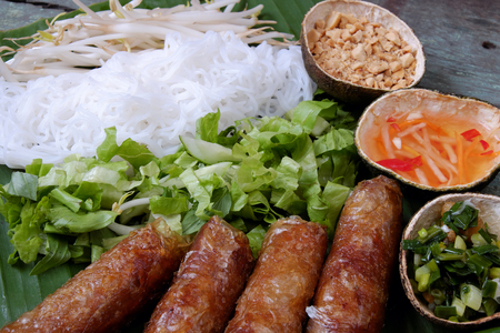 fatty food: Vietnamese food, spring roll or cha gio, a delicious fried food with cylinder shape, eat with bun, salad and fish sauce, this also rich calories, cholesterol, fatty food, popular Vietnam eating