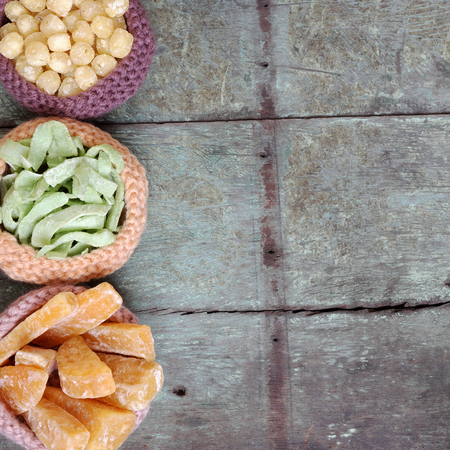 traditional custom: Vietnamese food for Tet holiday in spring, jam is traditional food on lunar new year, can make from sweet potato, lotus seed, ginger with suger, colorful background for Vietnam custom Stock Photo