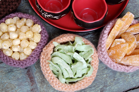 suger: Vietnamese food for Tet holiday in spring, jam is traditional food on lunar new year, can make from sweet potato, lotus seed, ginger with suger, colorful background for Vietnam custom Stock Photo