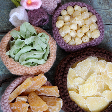 vietnamese food: Vietnamese food for Tet holiday in spring, jam is traditional food on lunar new year, can make from sweet potato, lotus seed, ginger with suger, colorful background for Vietnam custom Stock Photo