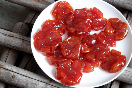 traditional custom: Vietnamese food for Tet holiday in spring, tomato jam, sweet eating is traditional food on lunar new year, can make from tomato cook with sugar,  amazing background for Vietnam custom