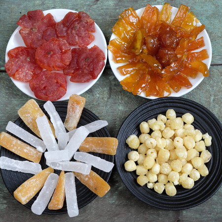 vietnam culture: Amazing of Vietnamese food for Tet holiday in spring, jam is traditional food on lunar new year, make from sweet potato, lotus seed, ginger, mango with sugar, colorful background for Vietnam culture