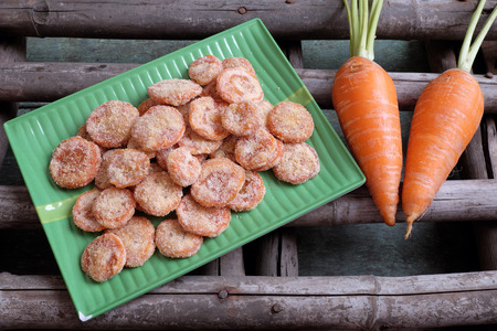 vietnam culture: Vietnamese food for Tet holiday in spring, carrot jam, sweet eating is traditional food on lunar new year, can make from carrots cook with sugar,  amazing background for Vietnam culture