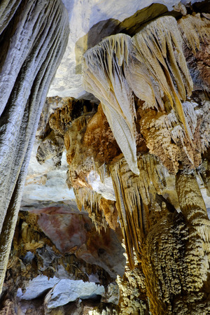 paradise place: Paradise cave, an amazing, wonderful cavern at Bo Trach, Quang Binh, Vietnam, underground beautiful place for travel, heritage national with impression formation, abstract shape from stalactite