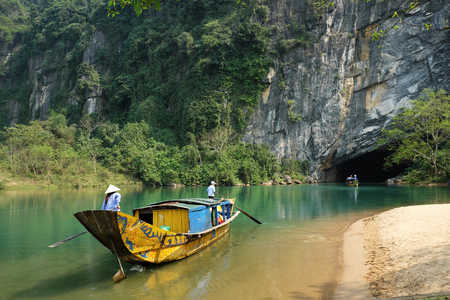 tourist: Phong Nha, Ke Bang cave, an amazing, wonderful cavern at Bo Trach, Quang Binh, Vietnam, is world heritage of Viet Nam,  traveller visit by boat on water,  wonderful place for travel Editorial