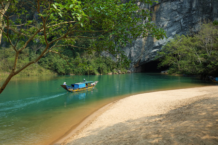 a wonderful world: Phong Nha, Ke Bang cave, an amazing, wonderful cavern at Bo Trach, Quang Binh, Vietnam, is world heritage of Viet Nam,  traveller visit by boat on water,  wonderful place for travel Editorial