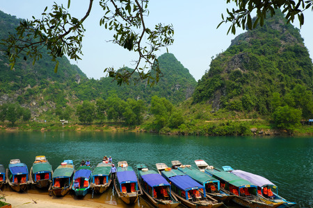 a wonderful world: QUANG BINH, VIET NAM- FEB 22: Phong Nha, Ke Bang cave, an amazing, wonderful cavern at Bo Trach, Vietnam, is world heritage of Viet Nam, traveller visit by boat on water, Feb 22, 2016 Editorial