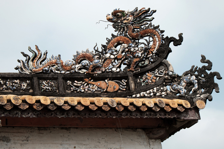 ngo: HUE, VIET NAM- FEB 19, 2016: Citadel, an culture heritage with Hoang Thanh (Imperial City),Tu Cam Thanh (Forbidden City), Dai Noi (Inner city), ngo mon (noon gate),  detail of roof of ancient Vietnam Editorial