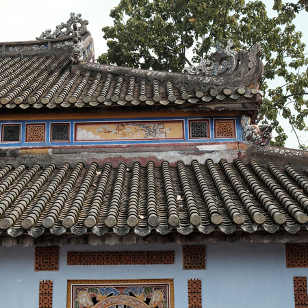 inner city: HUE, VIET NAM- FEB 19, 2016: Citadel, an culture heritage with Hoang Thanh (Imperial City),Tu Cam Thanh (Forbidden City), Dai Noi (Inner city), ngo mon (noon gate),  detail of roof of ancient Vietnam Editorial