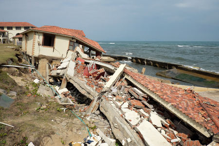unsafe: Erosion at seaside resort from climate change situation, wave broken building, very unsafe, danger, environment risk of worldwide when sea level rise by warming, scene at Cua Dai, Hoi An, Vietnam
