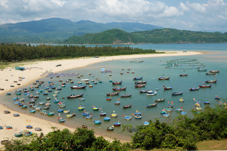 fishing scene: Amazing scene at fishing village in Phu Yen, Viet Nam, crowded of circle boat floating on water, valley of fishing boat at Vietnam channel, group of coracle in panoramic view, beautiful seascape