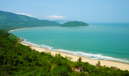 Beautiful landscape of Lang Co beach from Hai Van mountain pass, wonderful shape of nature with green jungle, place for eco travel at Hue, Vietnam is country of sea with long seaside