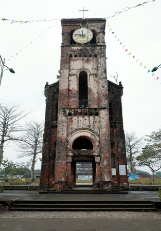 faithful: QUANG TRI, VIET NAM- FEB 20, 2016: Old church at La Vang holy land with ancient red brick wall, a place for Christian faithful to go pilgrimage, amazing old architect at Quangtri, Vietnam