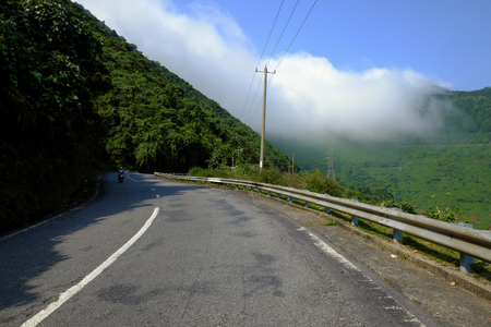 mountain pass: Hai Van mountain pass link Da Nang and Hue, a road with danger bend, beautiful nature with green scene, sea and cloud, wonderful journey for adventure taste Stock Photo