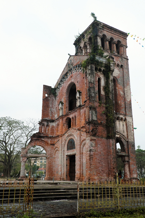 holy land: QUANG TRI, VIET NAM- FEB 20, 2016: Old church at La Vang holy land with ancient red brick wall, a place for Christian faithful to go pilgrimage, amazing old architect at Quangtri, Vietnam