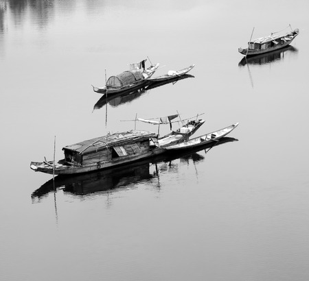 work boat: Beautiful landscape at Quang Binh countryside, Viet Nam on day, group of row boat floating on river at fishing village, poor Vietnam people work for live as fisherman and they live on water