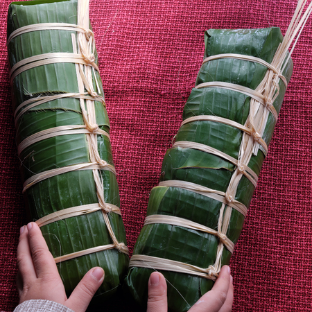 vietnamese food: Vietnamese food, traditional food on tet holiday in spring, banh tet also name Cylindric glutinous rice cake, make from sticky rice, mung been, cover by banana leaf, tradition eating on lunar new year