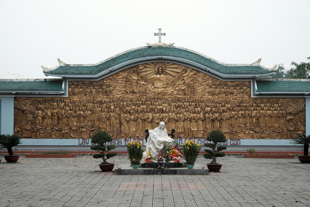 QUANG TRI, VIET NAM- FEB 20, 2016: Blessed Virgin Mary at La Vang holy land with ancient architect, a place for Christian faithful to go pilgrimage at Quangtri, Vietnam