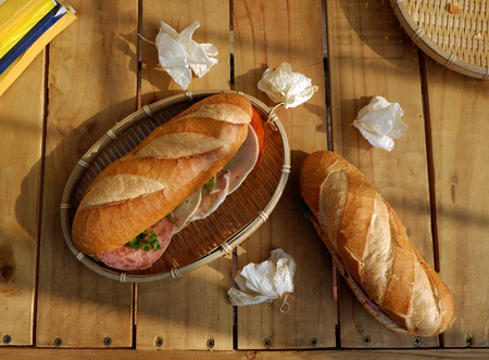 mi: Vietnamese food, banh mi Viet Nam, a famous eating for morning with tasty and convenient for modern life, bread on table for breakfast as fast food product in Vietnam