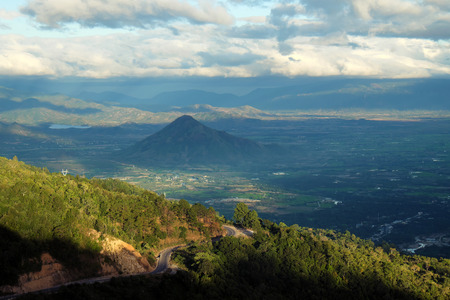 rang: Amazing landscape of Ngoan Muc mountain pass, a dangerous road link Phan Rang with Dalat of Vietnam, beautiful scene with mountain terrain among forest in evening