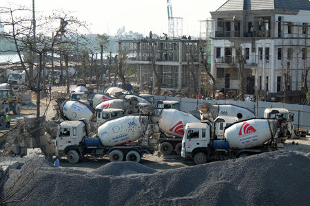 concrete mixer truck: HO CHI MINH CITY, VIET NAM- JAN 15, 2016: Concrete mixing plant to make building material for construction industry with group of concrete mixer truck to transport at Vietnam Editorial